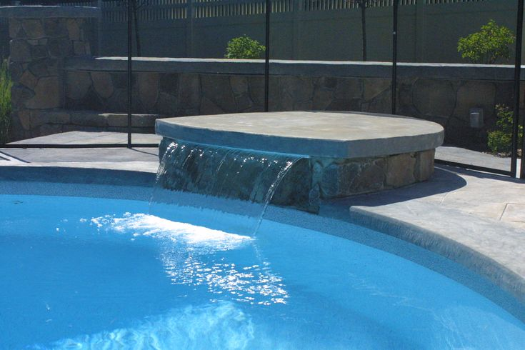Diving rock with waterfall  Water features  Pinterest  More Pool remodel ideas
