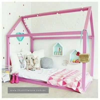 Pink house bed that fits in a modern kids room.