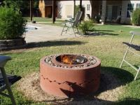 Fire pit with weber grill, gravel and tree rings. | Weber ...