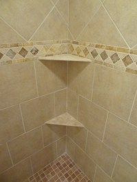 Our own ceramic shower wall and floor tile, border detail