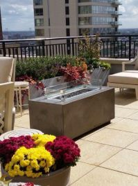 Rooftop deck w/ Rettinger Fireplace Firepit table ...