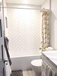 Guest shower. Herringbone white subway tile gray grout ...