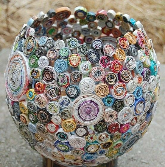 Great way to recycle old magazines! Just roll them up, glue to an inflated balloon, let it dry and pop the balloon.