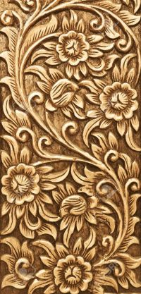 Pattern Of Flower Carved On Wood Background Stock Photo