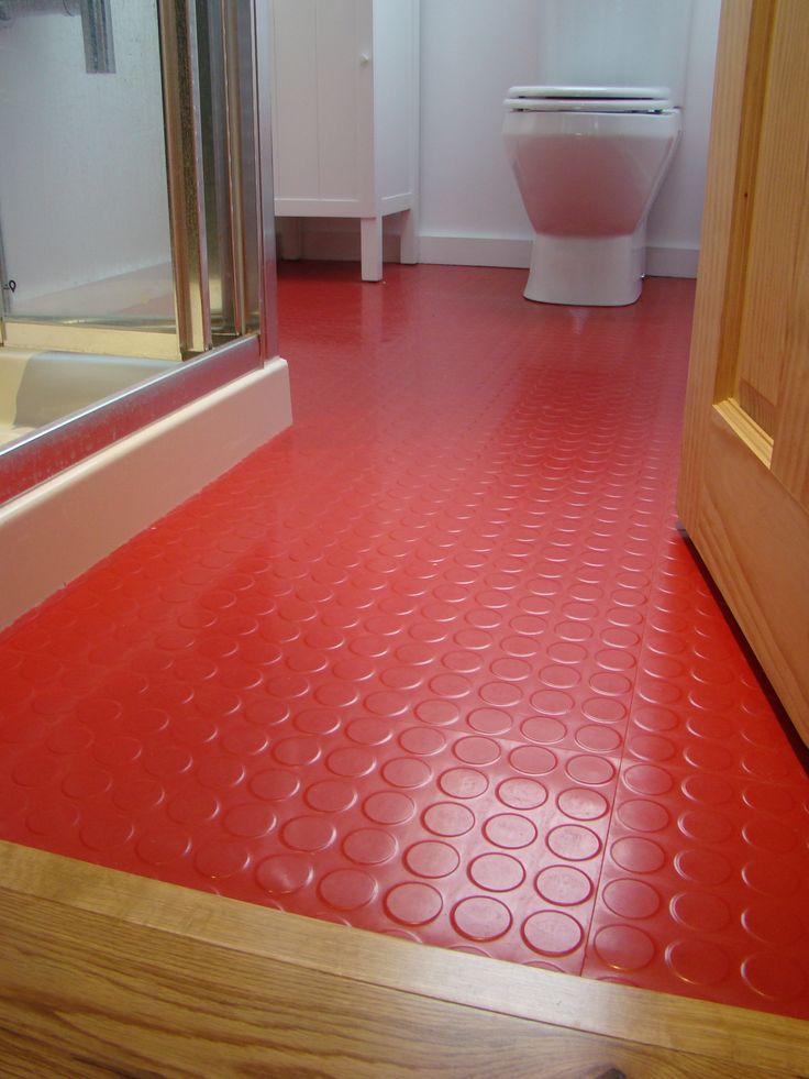 Red rubber flooring from Polyflor in bathroom  Bathroom