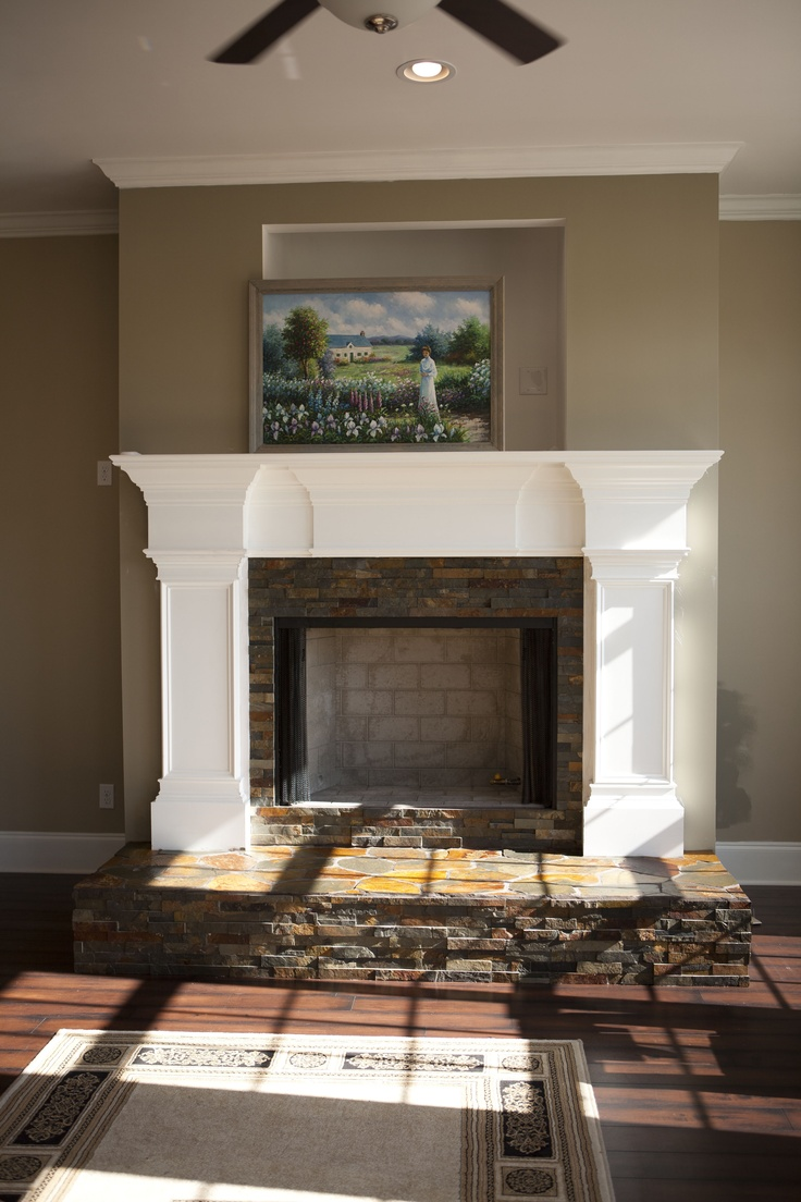 White Fire place frame on taupe walls
