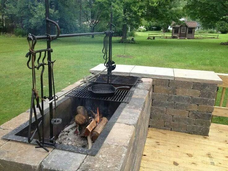 Built in fire pit! Hard wood, charcoal, etc. Cook on grill
