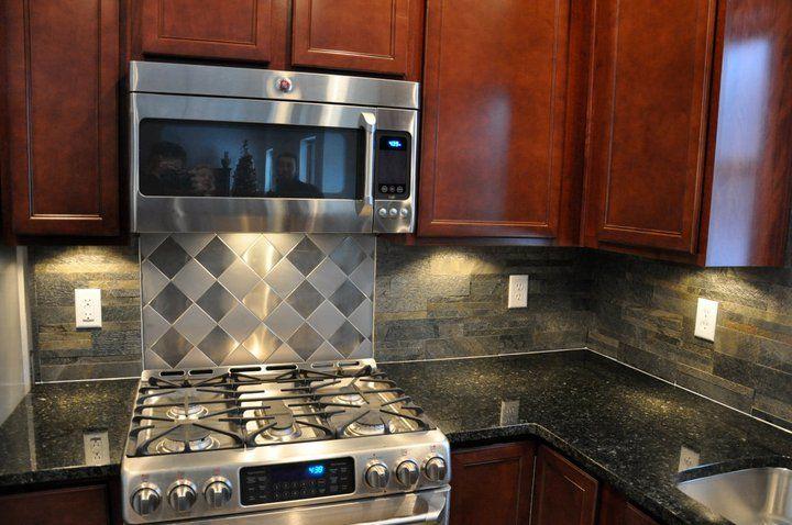 Cherry Cabinets And Ubatuba Granite Countertops With
