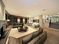 Open plan living room using beige colours with carpet ...