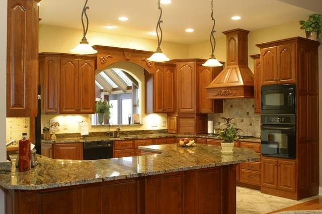 Golden Oak Kitchen Cabinets With Black Countertops