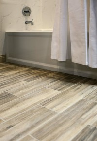 Faux Wood ceramic tile in the bathroom. Easy to clean and ...
