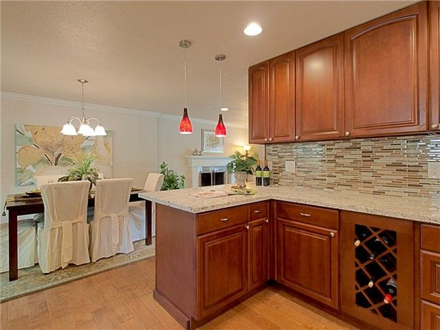 maple cognac wood kitchen cabinets with wood looking tile