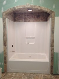 Bathtub tile... Like the idea of tile around and above ...