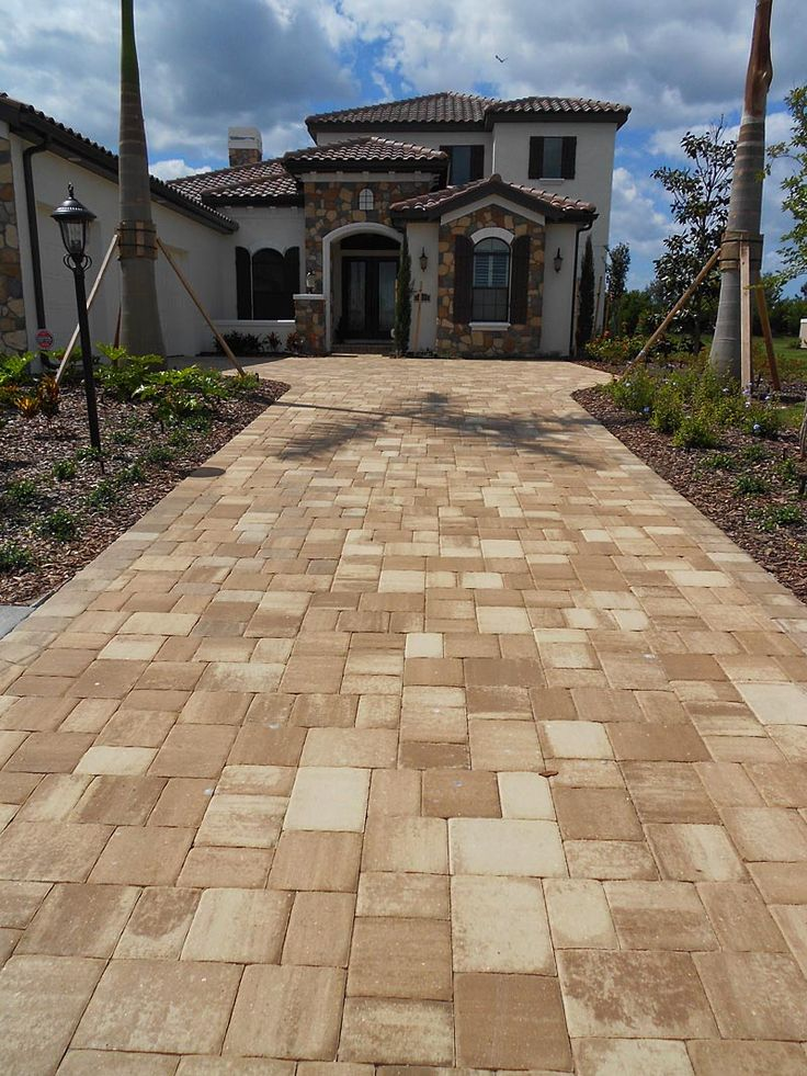 Mega Olde Towne Cappuccino paver driveway installed in a Herringbone Pattern by Decorative Paver