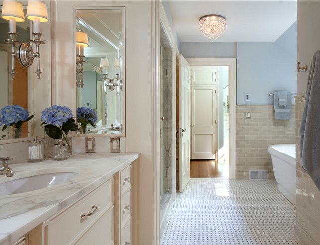Bathroom Ideas Bathroom with cream white cabinets and blue paint color on the walls This