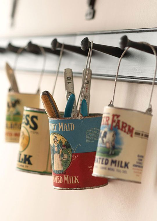 Hanging  cans with reproduction vintage labels corral tools, office supplies, or