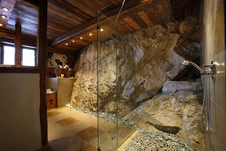 Massive stone shower in luxury Val dIsre chalet  Rustic