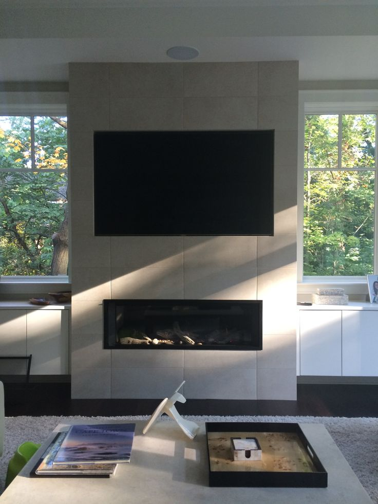 Valor L2 1700 Linear Direct Vent Fireplace Installed on outside wall with wide screen TV above