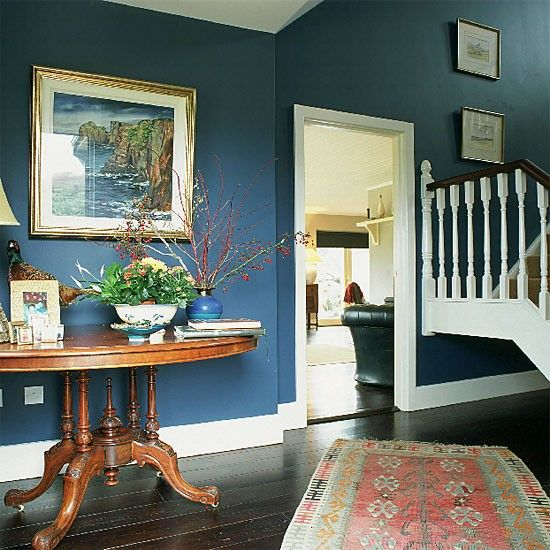 Hallway With Blue Walls Antique Table And Rug Blue