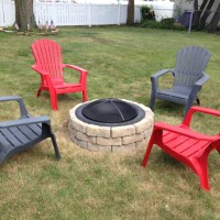 Stone fire pit. LOVE the adirondack chairs!