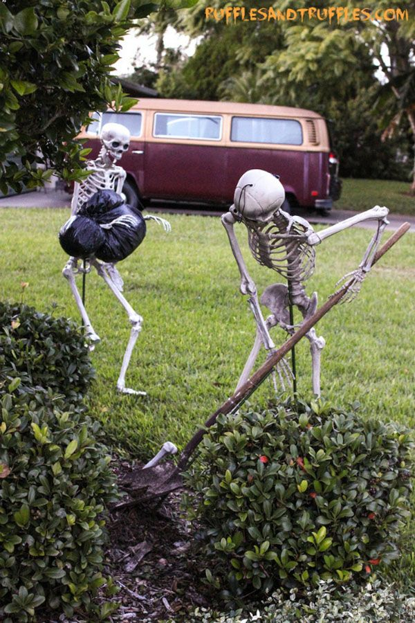 Krystie! Look! These peoples yard skeletons do yard work! (Hiding bodies in the yard is still yard work. Its work, and its in the