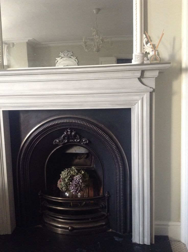 Fireplace makeover in Annie Sloan Chalk Paint undercoat and mantle French Linen top coat Old