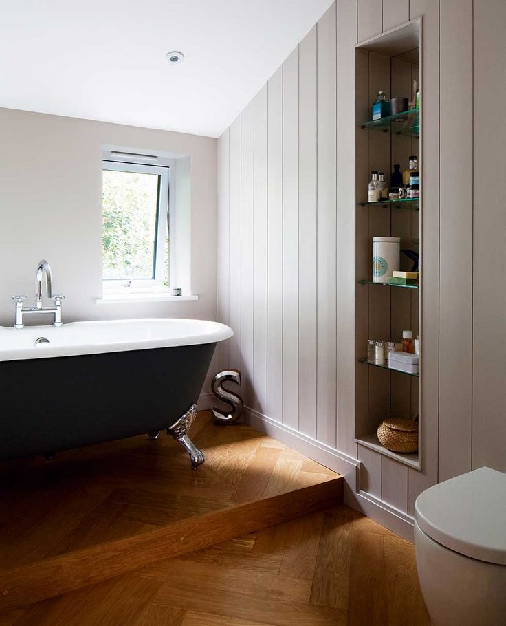 The Bathroom Has A Raised Platform For The Freestanding