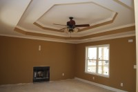 Double step tray ceiling. The color of the living room is ...