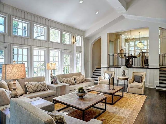 large open floor plan white living room traditional decor neutral colors two story windows