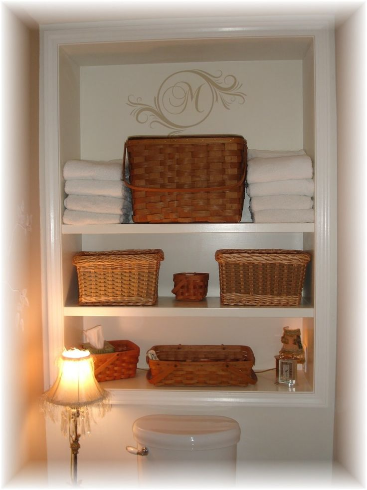 Bathroom elegant white tone bathroom shelves with rattan wicker basket Astounding Above The