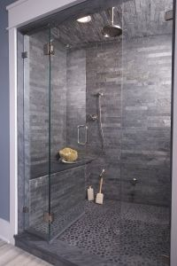 Wow love this dark stone shower cave!! Pebble flooring and ...