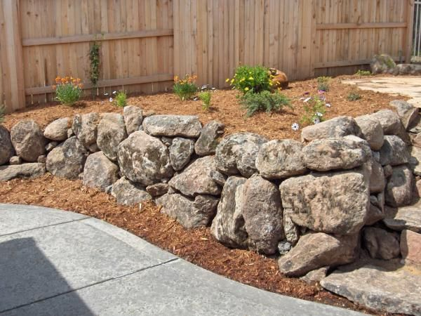 moss rock retaining wall - random