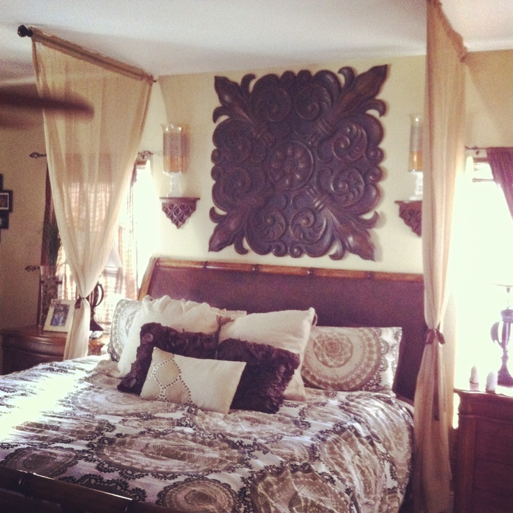 Curtain rods  window drapes hung over bedromantic