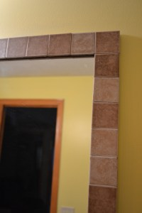 Tile border around a standard bathroom mirror. So easy and ...