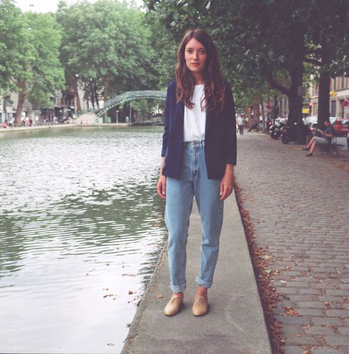 Heloise, one of our French employee and model, is wearing the High Waist Jean in Medium Wash Indigo and the Women's Blazer in Navy by #AmericanApparel.: