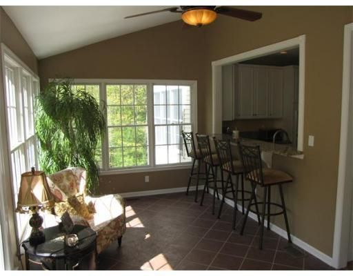 Kitchen with bar opening into sunroom  Home RenoFamily