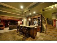 open staircase with wood and iron, stone floor, custom bar ...