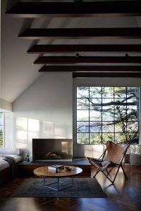 mid century modern living room with vaulted ceiling and ...