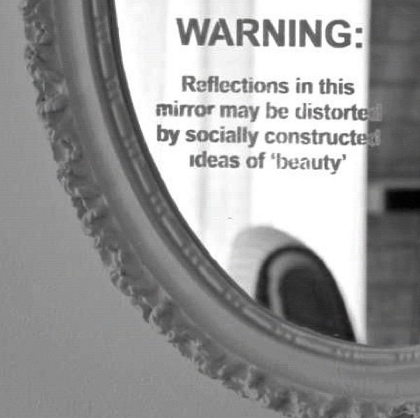 Warning Reflections In This Mirror May Be Distorted Due