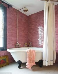 Bathroom with pink subway tile and black painted window ...