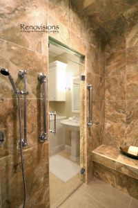 Master bathroom remodel by Renovisions. Tile shower, bench