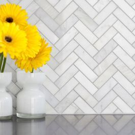 Herringbone kitchen backsplash. I like herringbone patterns. Very modern.