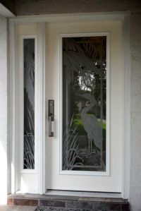 Etched glass egret with palmtrees on hurricane impact ...
