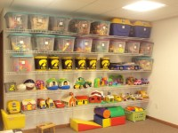 A organized playroom. Wire shelving from Lowes, some totes ...
