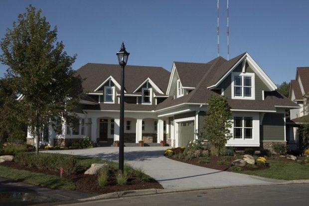 Modern Cape Cod Home Exterior High Contrast White Trim
