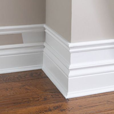 Make your baseboard more dramatic…add small pieces of trim to the top of existing baseboard, add a few inches and add another piece of moulding. Paint the wall and trim white. Cheap