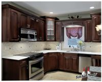 This simple, yet classic kitchen features Cordovan Cherry ...