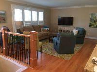 Photo of living room of split foyer remodel.   White ...