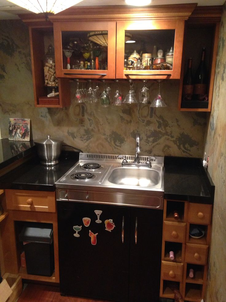 Wet bar with stovetop and fridge  DIY bar with slate veneer walls and fish tank  Pinterest