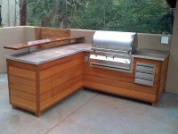 outdoor kitchen - bbq island made to look like wooden ...